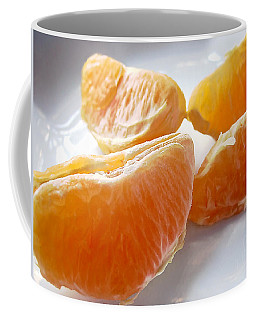 Juicy Orange Slices On A Blue Glass Plate Coffee Mug by Louise Kumpf