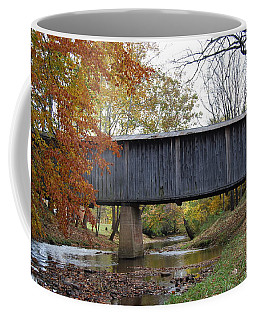 Coffee Mug featuring the photograph Kissing Bridge At Fall by Eric Liller