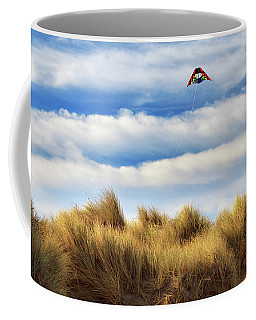 Coffee Mug featuring the photograph Kite Over The Hill by James Eddy
