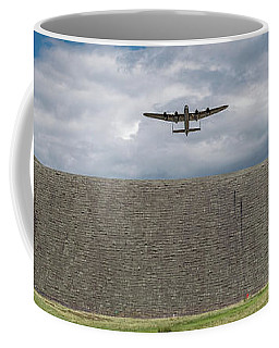 Coffee Mug featuring the photograph Lancaster Over The Derwent Dam by Gary Eason