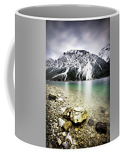 Landscape Of Plansee Lake And Alps Mountains During Winter, Snowy View, Tyrol, Austria. Coffee Mug