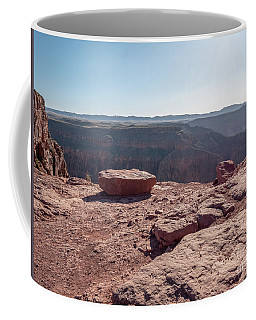 Coffee Mug featuring the photograph Large And Flat Red Toned Rock With The Grand Canyon West Rim In  by PorqueNo Studios