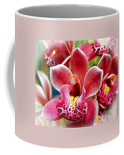 Coffee Mug featuring the photograph Laughing Orchids by Sue Melvin