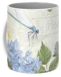 Coffee Mug featuring the painting Le Petit Jardin 2 - Garden Floral W Dragonfly, Butterfly, Daisies And Blue Hydrangeas by Audrey Jeanne Roberts