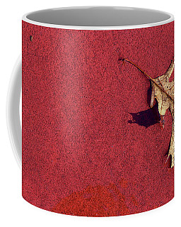 Leaf On Basketball Court Coffee Mug by Mary Bedy