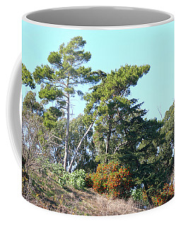 Leaning Trees On Hillside Coffee Mug