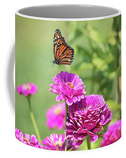 Coffee Mug featuring the photograph Leaping Butterfly by Brian Hale