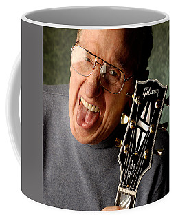 Les Paul With Tongue Out By Gene Martin Coffee Mug