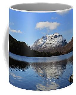 Coffee Mug featuring the photograph Liathach Reflecting In Loch Clair by Maria Gaellman