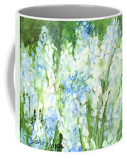 Coffee Mug featuring the painting Light Blue Grape Hyacinth. by Laurie Rohner