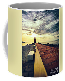 Coffee Mug featuring the photograph Lighthouse At Sunset by Silvia Ganora