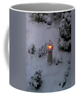 Coffee Mug featuring the photograph Lighthouse In The Snow by Kathryn Meyer