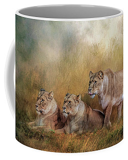 Lionesses Watching The Herd Coffee Mug by Brian Tarr