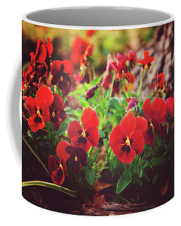 Coffee Mug featuring the photograph Little Red Pansies by Toni Hopper