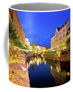 Ljubljanica River Waterfront In Ljubljana Evening View Coffee Mug by Brch Photography