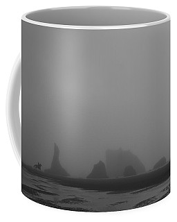 Coffee Mug featuring the photograph Lone Rider by Dylan Punke