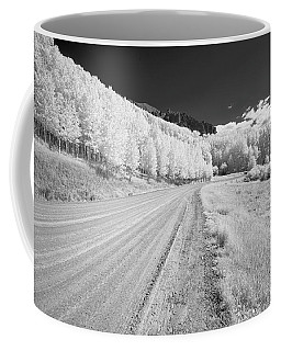 Coffee Mug featuring the photograph Long Road In Colorado by Jon Glaser