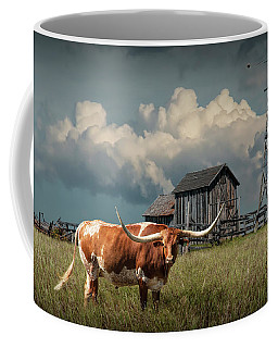 Longhorn Steer In A Prairie Pasture By Windmill And Old Gray Wooden Barn Coffee Mug