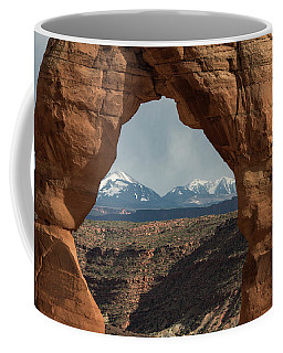 Looking Through Delicate Arch Coffee Mug