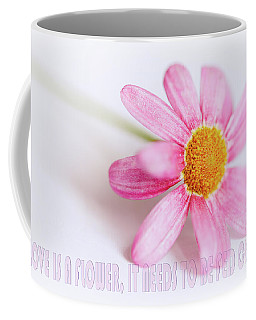 Coffee Mug featuring the photograph Love Is A Flower by Nick Biemans