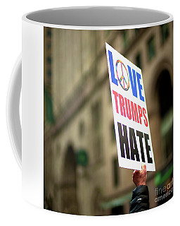 Love Trumps Hate Coffee Mug by John Rizzuto