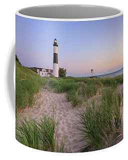 Coffee Mug featuring the photograph Ludington Beach And Big Sable Point Lighthouse by Adam Romanowicz