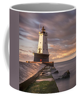 Coffee Mug featuring the photograph Ludington North Breakwater Light At Dawn by Adam Romanowicz