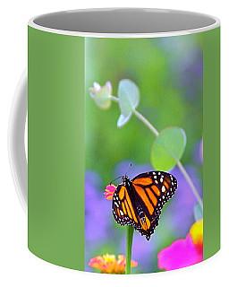 Coffee Mug featuring the photograph Magical Monarch by Byron Varvarigos