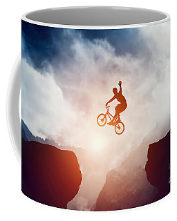 Man Jumping On Bmx Bike Over Precipice In Mountains At Sunset Coffee Mug