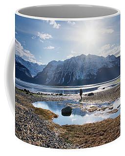 Man Walking On Southeast Alaskan Beach Coffee Mug