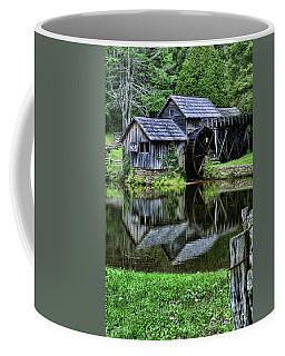 Coffee Mug featuring the photograph Marby Mill Reflection by Paul Ward