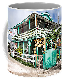 Coffee Mug featuring the photograph Marin's On Caye Caulker by Lawrence Burry