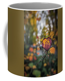 Coffee Mug featuring the photograph Marked by Gene Garnace