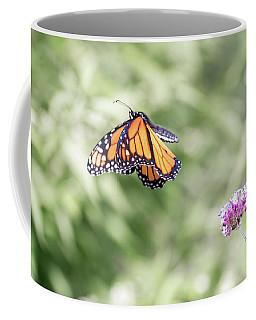 Coffee Mug featuring the photograph Mid-air Monarch 1 by Brian Hale