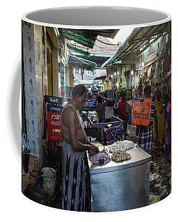 Coffee Mug featuring the photograph Mincing Garlic by Mike Reid