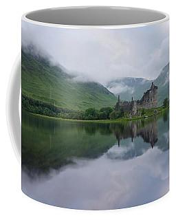 Mist Swarms Around Kilchurn Castle Coffee Mug