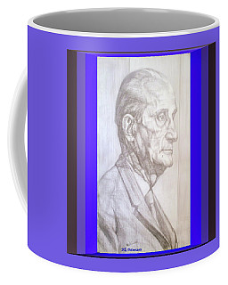 Coffee Mug featuring the photograph Model Framed by Elly Potamianos