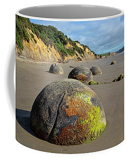 Coffee Mug featuring the photograph Moeraki Boulders by Cheryl Strahl