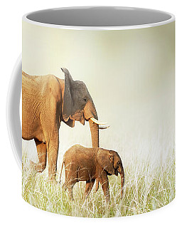 Mom And Baby Elephant Walking Through Tall Grass Coffee Mug
