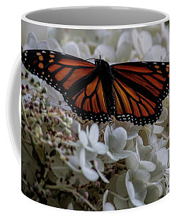Monarch Butterfly Feeding On Hydrangea Tree Coffee Mug