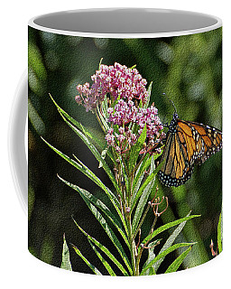 Coffee Mug featuring the photograph Monarch On Milkweed by Sandy Keeton
