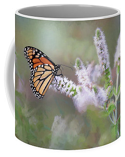 Coffee Mug featuring the photograph Monarch On Mint 1 by Lori Deiter