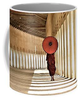 Monk With Umbrella Walking In Th Light Passway Coffee Mug