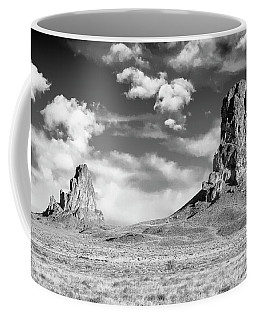 Coffee Mug featuring the photograph Monoliths by Jon Glaser