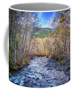 Moody Blue River Coffee Mug by Spencer McDonald