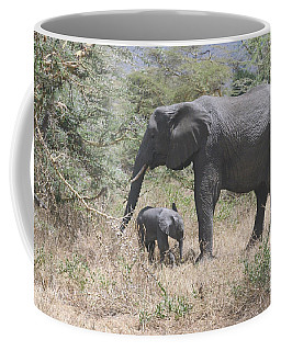 Mother Elephant With Baby Foraging Coffee Mug