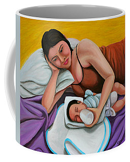Mother Feeding Her Baby Coffee Mug by Cyril Maza