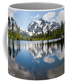Mount Shuksan Reflected In Picture Lake Coffee Mug by Jeff Goulden