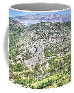 Coffee Mug featuring the pyrography  Mountain Road by Yury Bashkin