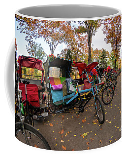 Coffee Mug featuring the photograph Multiple Colorful Bicycles In A Row In Central Park During Fall  by PorqueNo Studios